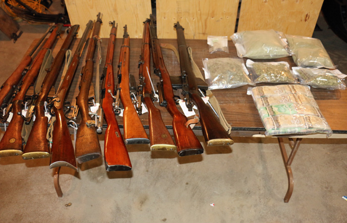 Firearms, drugs and cash